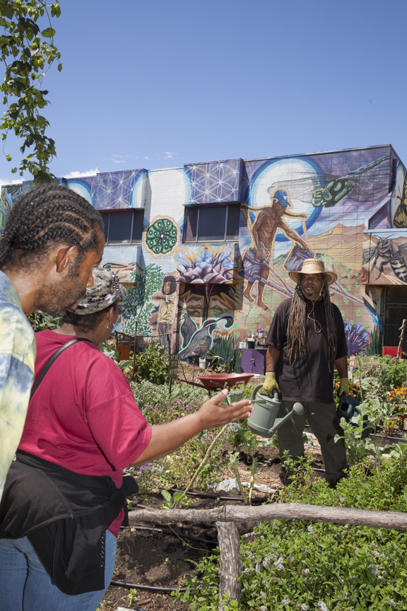PeeWee and Veronica, neighbors stop by and talk to Donald Theard the volunteer gardener at People's Grocery garden at 7th and Market in West Oakland.