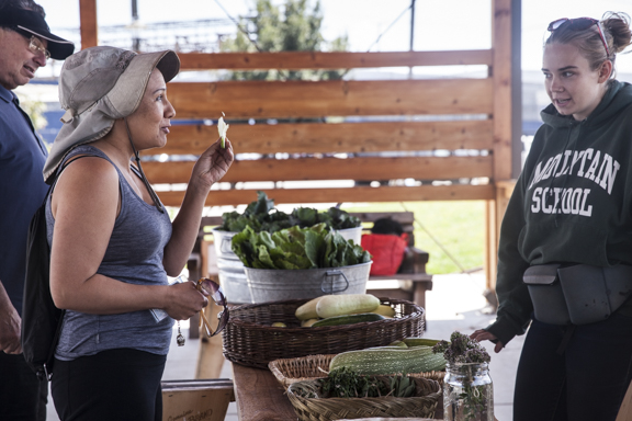 Rachel Rehmet (in hat) at the City Slicker Farm stand.